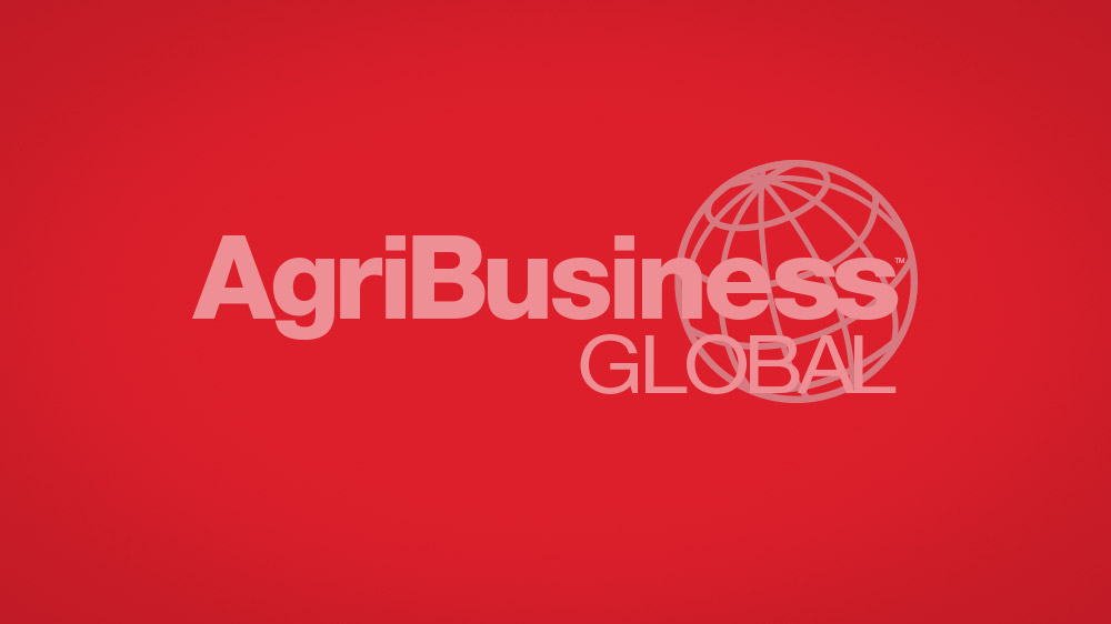 Red-to-black gradient background with the AgriBusiness Global logo and globe icon behind it.