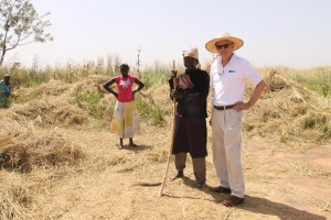 Scott Angle spent much of his early tenure touring IFDC facilities in Africa. Here he visits with farmers in Ghana.
